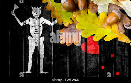 Blackbeard Pirate flag on autumn wooden background with leaves and good place for your text. - Stock Photo