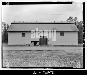 Planar view of front (east) side, view towards westside west with scale - Fort McClellan Ammunition Storage Area, Building No. 4404, Second Avenue (Magazine Road), Anniston, Calhoun County, AL - Stock Photo
