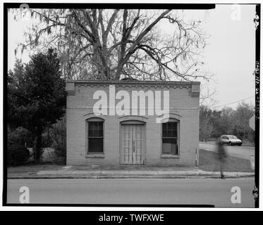 Planar view of front (north) side of building, facing southeast. - Troup Store, South side of U.S. Highway 84, east of Roe Street, Stockton, Lanier County, GA - Stock Photo