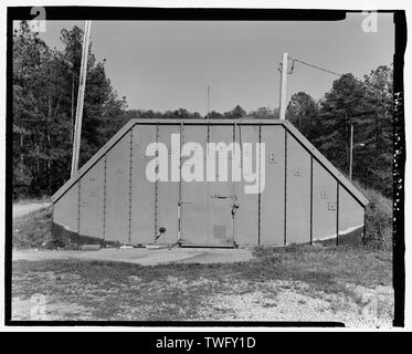 Planar view of front (west) side, view towards the east northeast, with scale - Fort McClellan Ammunition Storage Area, Building No. 4414, Second Avenue (Magazine Road), Anniston, Calhoun County, AL - Stock Photo