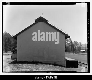 Planar view of rear (west) side, view towards the east northeast with scale - Fort McClellan Ammunition Storage Area, Building No. 4403, Second Avenue (Magazine Road), Anniston, Calhoun County, AL - Stock Photo