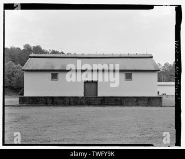 Planar view of rear (west) side, view towards east northeast with scale - Fort McClellan Ammunition Storage Area, Building No. 4404, Second Avenue (Magazine Road), Anniston, Calhoun County, AL - Stock Photo