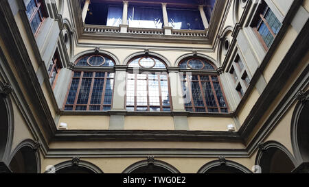 View of the inner courtyard of Palazzo Strozzi facade in Florence, Tuscany, Italy - Stock Photo