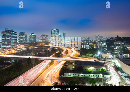 City skyline and traffic on highway at night, Sao Paulo, Brazil - Stock Photo