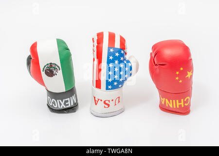 Mini U.S, China & Mexico boxing gloves. Metaphor for U.S trade relations / U.S trade tariffs with Mexico and China, trade war. - Stock Photo