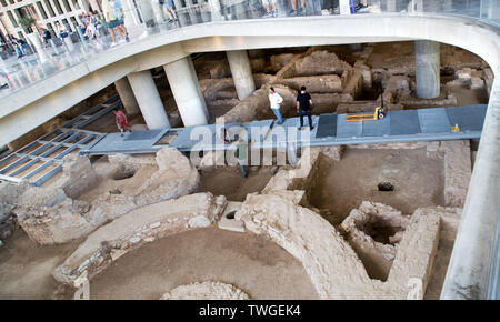 The newest exhibit at the New Acropolis Museum in Athens Greece is the excavated ancient town underneath the museum - Stock Photo