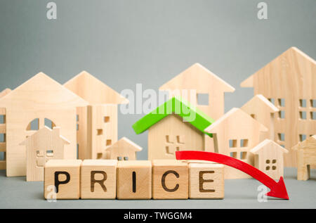 Wooden blocks with the word Price, down arrow and miniature houses. Reduced housing prices. The fall and crisis of the real estate market. Bankruptcy. - Stock Photo