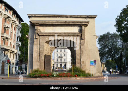 Milan/Italy - October 10, 2015: Internal view from the part of the city to the Porta Romana ancient gate of Milan with 2 enormous old wooden doors. - Stock Photo