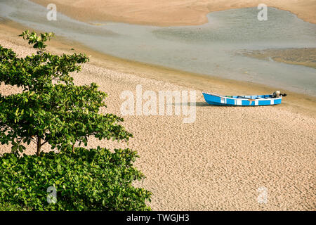The lone fishing boat - Stock Photo