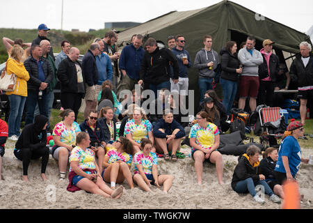 Spectators at a beach rugby tournament  on 8 June 2019 at Port Ellen on Islay in inner Hebrides in Scotland, UK - Stock Photo