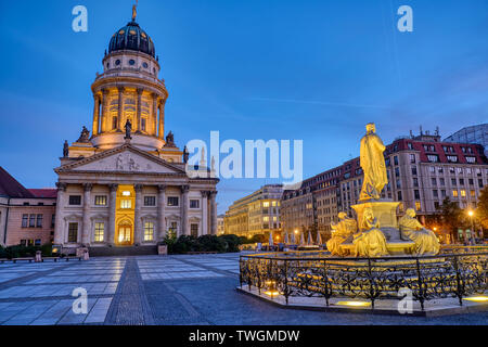 The French Cathedral and the Schiller Monument at the Gendarmenmarkt in Berlin at dawn - Stock Photo