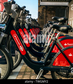 Hire bikes ,a line of santander Boris bikes London ,Santander Cycles - Transport for London - Stock Photo