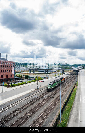 Looking south from the Bridge of Glass to the railroad, Tacoma Dome and East 21st Street Bridge and past the Albers Mill Lofts in Tacoma, Washington. - Stock Photo