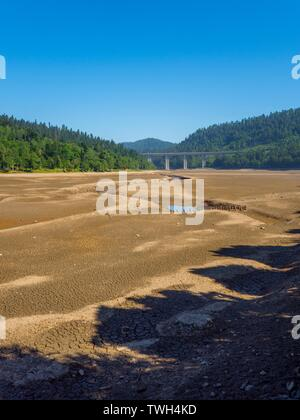 Dried lake-bed Bajer in Fuzine Croatia Spring 2019 earth terrain with isolated small ponds