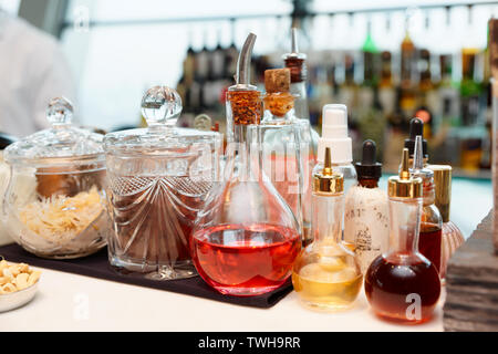 Bitters, spices and infusions on bar counter - Stock Photo