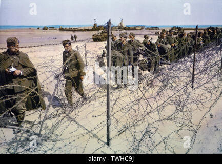Captured German Soldiers Kept in Barbed Wire Enclosure on Beach during Invasion of Normandy, France, June 1944 - Stock Photo