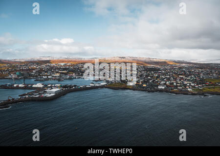 Aerial shot of the town Torshavn and its harbour as taken during a helicopter flight on an early spring morning  (Faroe Islands, Denmark, Europe) - Stock Photo