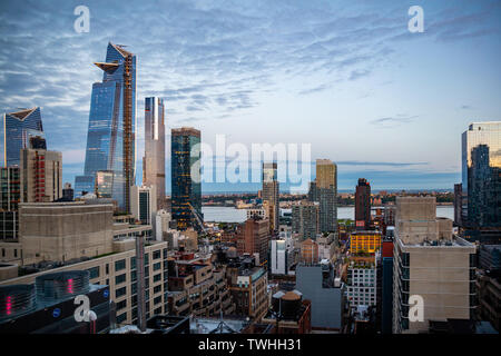 New York, USA. May 6th, 2019. City skyline. Aerial view of Manhattan skyscrapers and Empire state building, blue sky with clouds background