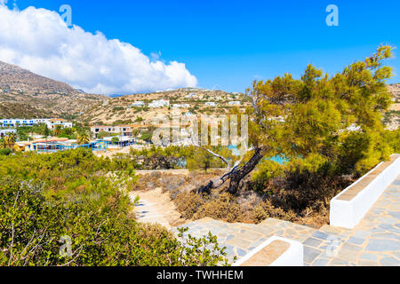 Path from church to Ammopi village with mountains in background, Karpathos island, Greece - Stock Photo