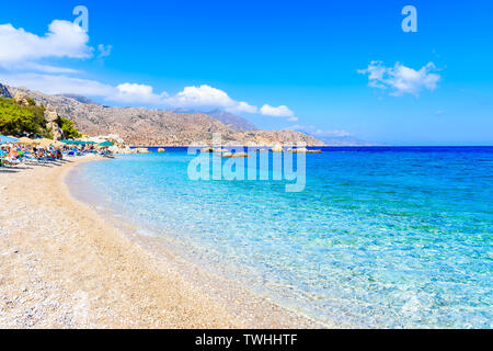 Azure sea at Apella beach on Karpathos island, Greece - Stock Photo