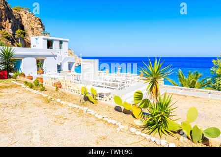 Taverna buildings on Kyra Pynagia beach, Karpathos island, Greece - Stock Photo