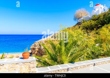 View of Kyra Pynagia beach and Greek chapel on hill top, Karpathos island, Greece - Stock Photo