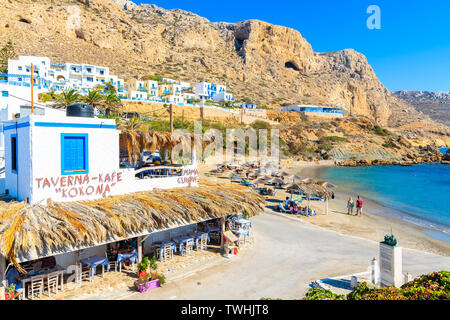 FINIKI PORT, KARPATHOS ISLAND - SEP 25, 2018: Typical Greek taverns in Finiki port on Karpathos island. Greece is very popular holiday destination in - Stock Photo