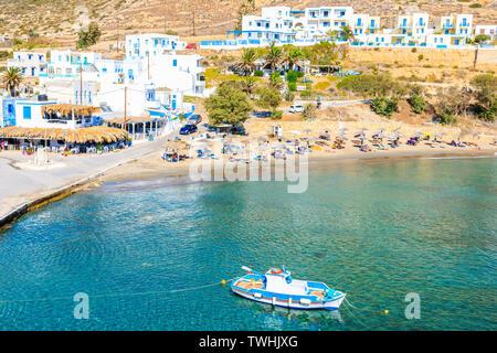 Fishing boat on turquoise sea water in Finiki port, Karpathos island, Greece - Stock Photo