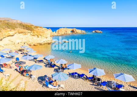 KARPATHOS ISLAND, GREECE - SEP 26, 2018: People relaxing on beautiful beach on Karpathos island near Ammopi village, Greece. - Stock Photo
