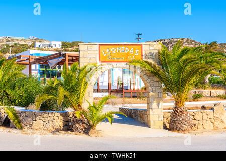AMMOPI VILLAGE, KARPATHOS ISLAND - SEP 26, 2018: View of taverna restaurant and white houses in small village on coast of Karpathos island, Greece. - Stock Photo