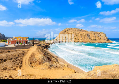 View of beautiful bay with sea waves hitting shore near Lefkos beach, Karpathos island, Greece - Stock Photo