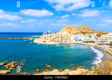 View of Finiki port and beach on sea coast of Karpathos island, Greece - Stock Photo