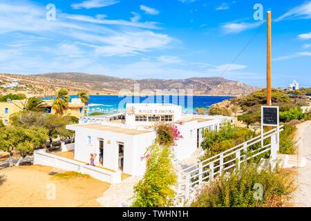 KARPATHOS ISLAND, GREECE - SEP 26, 2018: Traditional white building of Greek taverna near beautiful beach on Karpathos island in Ammopi village, Greec - Stock Photo