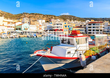 Fishing boat in picturesque Pigadia port, Karpathos island, Greece - Stock Photo