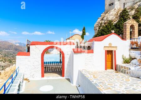 Traditional white church in Menetes mountain village, Karpathos island, Greece - Stock Photo