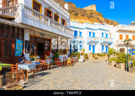 KARPATHOS ISLAND, GREECE - SEP 29, 2018: Street with colorful houses in Olympos mountain village which is most famous attraction on the island. - Stock Photo