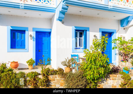 Typical white and blue color Greek house in Olympos mountain village on Karpathos island, Greece - Stock Photo