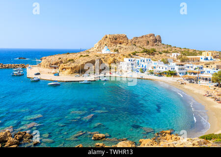 Beautiful sea bay with in Finiki village on coast of Karpathos island, Greece - Stock Photo