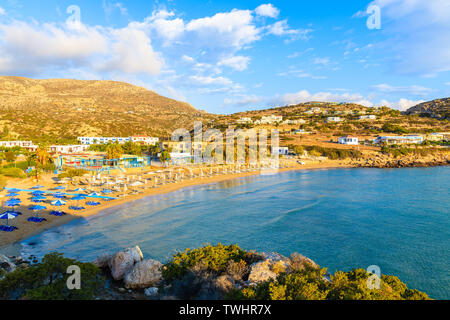 Amazing bay with beach in Ammopi village at sunset time, Karpathos island, Greece - Stock Photo