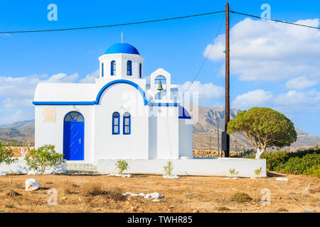 Traditional white church in rural landscape of Karpathos island, Greece - Stock Photo