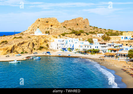 View of bay and beach in Finiki port, Karpathos island, Greece - Stock Photo