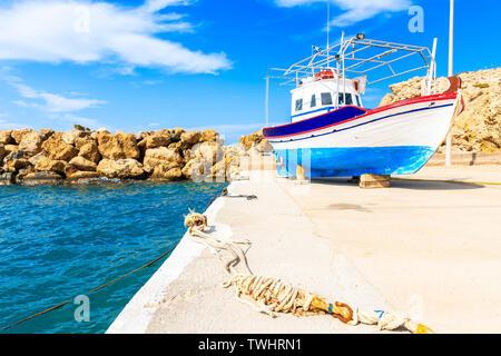 Fishing boat in Finiki port on Karpathos island, Greece - Stock Photo