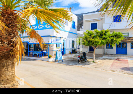 FINIKI PORT, KARPATHOS ISLAND - SEP 30, 2018: Typical Greek tavern on street of Finiki village, Karpathos island, Greece. - Stock Photo