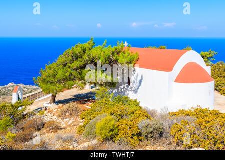 Small Greek church on beautiful sea coast near Mesochori village on Karpathos island, Greece - Stock Photo