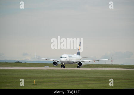 A Lufthansa, also known as Deutsche Lufthansa AG, Airbus A320 prepares for take off from Manchester International Airport in Wilmslow, United Kingdom - Stock Photo