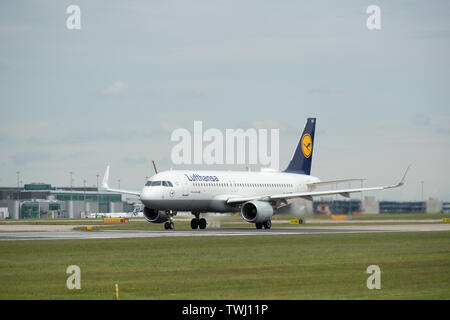 A Lufthansa, also known as Deutsche Lufthansa AG, Airbus A320 travels down Runway Two at Manchester International Airport in Wilmslow, United Kingdom - Stock Photo