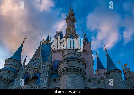 Orlando, Florida. May 10, 2019. Top view of Cinderella Castle on lightblue clody sky background in Magic Kingdom at Walt Disney World - Stock Photo