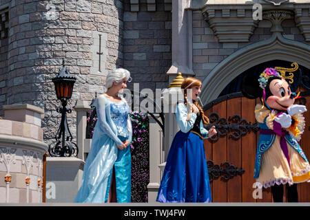 Orlando, Florida. May 17, 2019. Mickey's Royal Friendship Faire on Cinderella Castle in Magic Kingdom at Walt Disney World Resort - Stock Photo