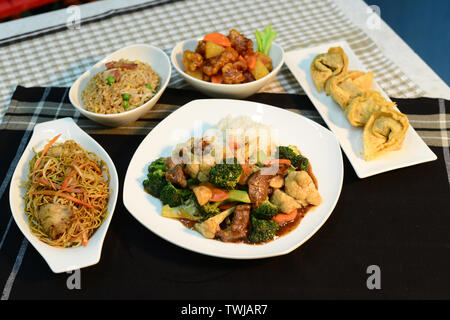 Chinese cuisine, setup nicely on table ready to serve - Stock Photo