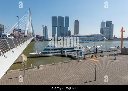 Rotterdam, Netherlands - April 18, 2019 : Rotterdam skyline with Erasmus bridge and New Meuse river on a clear day - Stock Photo